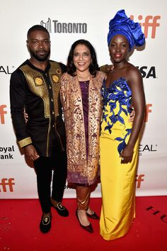 """David Oyelowo, director Mira Nair and actress Lupita Nyong'o arrive at the world premiere of Disney's """"Queen of Katwe"""" at Roy Thompson Hall as part of the 2016 Toronto Film Festival."""