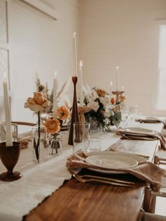 Neutral Boho Wedding Inspiration at Pearl Snap Hall in Austin, Texas Candlesticks + sun bleached flowers for rustic wedding table decor Bohemian Wedding Decorations, Wedding Table Decorations, Boho Wedding, Rustic Wedding, Wedding Goals, Bohemian Weddings, Peacock Wedding, Wedding Tables, Wedding Reception