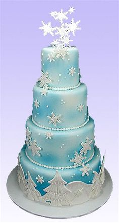 This cake shows the decoration of cake using an airbrush or new food spray cans, along with fondant snowflakes and designs.     This cake evokes the special spirit of the holiday along with the unique perfection needed for the perfect wedding.