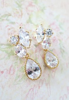 Tarnish resistant gold plated metal framed three shapes clear white cubic zirconia earrings with sterling silver post and 13mm clear white large cubic zirconia crystal tear drops (13mm excluding the hole, 15mm including the hole).  Luxury and elegant.  High quality gold finished. 925 sterling silve