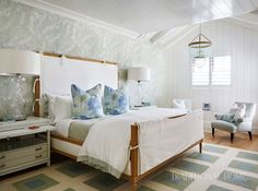 Anchored by a seaglass-colored rug, the guest bedroom is loaded with casual pattern. - Photo: Carmel Brantley / Design: Lisa Peterson and Melanie Hayes