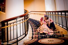 Indian wedding photography. Couple photo shoot ideas. Candid photography.  Indian bride wearing bridal lehenga and jewelry. #IndianBridalHairstyle #IndianBridalMakeup Groom wearing a sherwani and turban