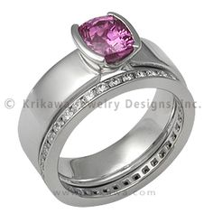 Modern Straight, Tapered Head Engagement Ring with a Pink Sapphire and Diamond Channel Band - This design is the same as the Modern Taper except with a straight band. The bezel is integrated into the band like the Modern Taper. This is a clean, sleek design that will elegantly showcase your stone. 5mm wide. This design will pair well with your fancy or plain wedding band.   - This custom Modern Straight, Tapered Head Engagement Ring has a two cutout head with a cushion-cut pink sapphire. The…