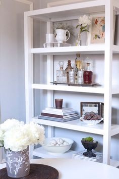 More bar ideas. Perhaps I'll use my bookcase as a bar as I had toyed with before. I need to find an amazing metal tray of some sort to keep it all together. It makes all the difference. That, and a bottle of Bombay. Can't resist the color.