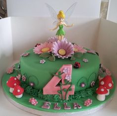 - Tinkerbell cake. I think someone made this for my Ella who will turn 4 in January! I hope they are keeping in the freezer for me. :) #FairyCakes,Yummy!