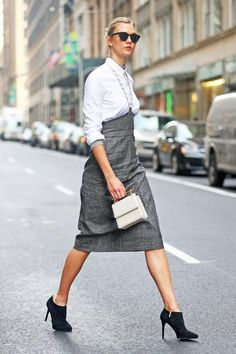 Karlie Kloss wearing Sunday Somewhere Soelae Sunglasses in Matte Black, Isa Arfen Chain Strap Midi Skirt, Isa Arfen Ribbed Jersey Base Top, Isa Arfen Classic Round Pocket Shirt, M2malletier Collectionneuse Mini Patent-Leather Shoulder Bag and Jimmy Choo Lindsey Booties in Black