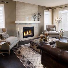 Wood grain horizontal tiles around fireplace. The Sierra Showhome | Morrison Homes
