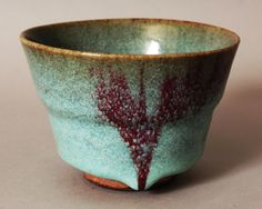 CHINESE SONG STYLE JUNYAO CERAMIC TEA BOWL, the pale blue glaze falling short of the unglazed foot and applied with purple splashes