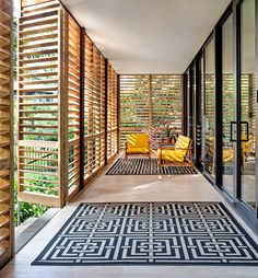 """""""The 800-square-foot porch has cypress floors covered with indoor-outdoor rugs from Safavieh that the couple bought on Overstock.com (about $77 and $116).""""   D.I.Y. Is in Their DNA - NYTimes.com"""