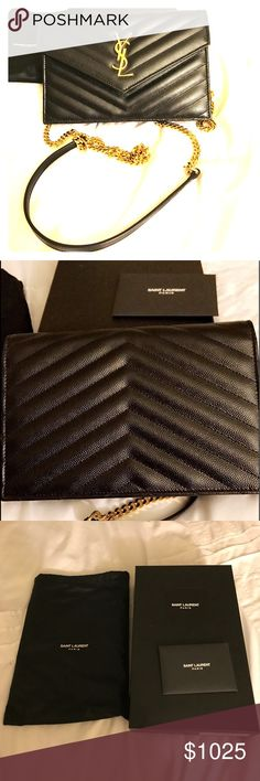 Saint Laurent Monogram Chain Wallet This elegant wallet on a chain is crafted of finely pebbled chevron quilted leather in black. This cross body features a waist-length gold chain shoulder strap with a shoulder pad and a gold classic YSL emblem on the flap. This opens to a black interior with card slots, a zipper pocket, and patch pockets. This stunning wallet is ideal for day or evening essentials! Saint Laurent Bags Crossbody Bags