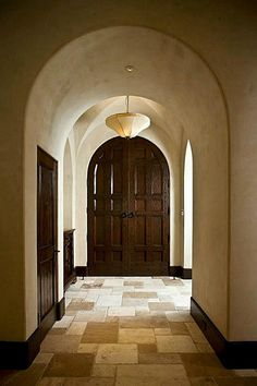 8802 Memorial Drive Houston, TX 77024: Photo   Foyer Classic Spanish Colonial Revival design, implemented with refined grace and a sure hand, creates a highly individual residence that stands apart from others in the genre.