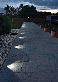 Recessed, in ground lighting suddenly turns this pathway into a nightime feature.