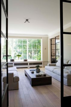 Black framed doors and the mix of wood flooring width