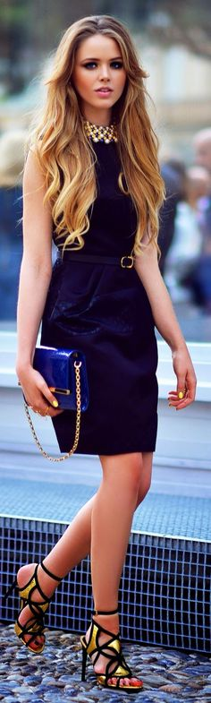 Gorgeous dark navy and black mix color sleeveless mini dress with gold combination and blue leather shining clutch and awesome ladies shoes the best way to show fashion  style