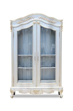 This fabulous Giselle display cabinet features intricate hand carved detailing and is the ultimate in 'French Boudoir' style finished in silver leaf. Superbly designed and hand crafted, this cabinet is perfectly suited for modern day living. A beautiful and elegant display or book case packed full of charm, style and sophistication and will be a stunning center piece in any room.#Fabulous&Baroque