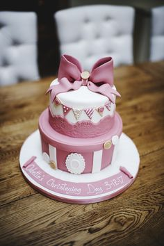 Christening Cake for baby girl. Classic, pink with a bow on top. 2 tiered chocolate biscuit cake.
