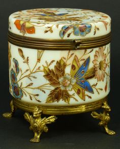 Antique Art Nouveau hand painted enameled milk glass dresser box having gilded brass frame.