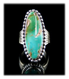 Look at the beautiful two town American Turquoise cabochon in this elegant Royston Turquoise Ring by John Hartman.