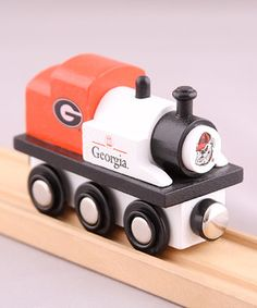 Choo, choo! Now arriving at College Station! Crafted from real wood, this tiny train engine boasts a pair of magnets that easily attach to other cars, operate free-style and is compatible with most wooden train sets. Painted in the school's colors and boasting its logo front and center, this locomotive is sure to keep little conductors' imaginations chugging along.