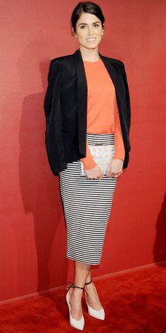 Nikki Reed wears a Rebecca Minkoff jacket, Tory Burch sweater, ASOS pencil skirt, Kate Space clutch, Bionda Castana heels, and a ring by N/Tice.