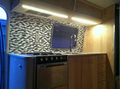 Airstream Renovation: Airstream Kitchen backsplash installed
