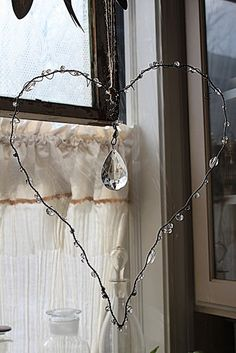 Wire heart to hang in a window.   Anyone could make one of these. :)