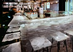 Tetchan bar by Kengo Kuma - melted acrylic stools. Photography: Erieta Attali