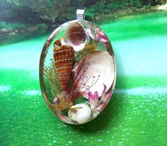 Sea Shell Seascape Resin Pendant Necklace. $25.95, via Etsy.