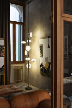 Martina is an adjustable floor to ceiling lamp with metal structure in matte graphite or bronze and shades in white blown glass and LED bulbs Floor Ceiling, Ceiling Lamp, Floor Lamps, Cool Lighting, Lighting Design, Interior Lighting, Custom Furniture, Luxury Furniture, Modern Spaces