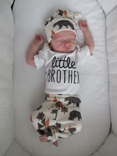 Our Little Brother Onesie is perfect for the tiniest man in your life :) Comes in Short Sleeve or Long Sleeve. Also, available in a Matching big brother shirt!