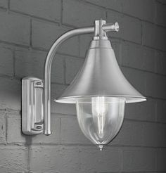 EXT6589 Lorenz exterior wall light, silver grey. A classic Italian lantern in brushed marine grade stainless steel with a transparent polycarbonate diffuser. Outdoor IP44 Rated 1 x 100w E27 Lamp not included Height- 35cm Width- 24.5cm Projection- 35cm BRAND- Franklite REFERENCE- EXT6589 AVAILABILITY: 3-4 Working Days