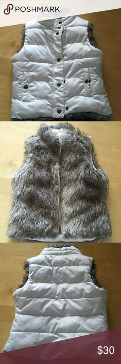 """Reversible Vest This is warm cozy puffer vest has side pockets with snaps, and working zipper. Size x-small/small (4-7).  Washing instructions read """"Machine wash in cold. Wash and dry with like colors. Tumble dry on low"""". Barely worn; in great condition. GAP Jackets & Coats Vests"""