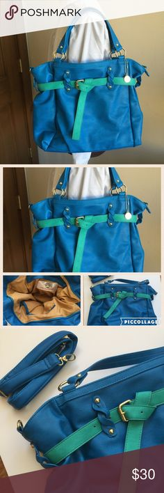 """💜💙 BIG BUDDHA HANDBAG 💜💙 Worn once. No scratches, stains or marks. Like brand new. Blue with green detail and gold hardware. Comes with detachable long shoulder strap. 18"""" long, 13"""" high, 5"""" wide. 7"""" drop.  Top zip closure. Beautiful tan interior with 1 large zip pocket and 2 slip pockets. Big Buddha Bags Shoulder Bags"""