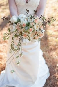 Vintage bouquet - love the rose buds hanging from ribbons.