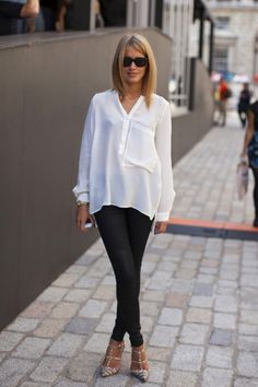 White shirt, untucked + black jeggings/leather pants + pointy toed shoes.... I'm loving the stylish simplicity of it!