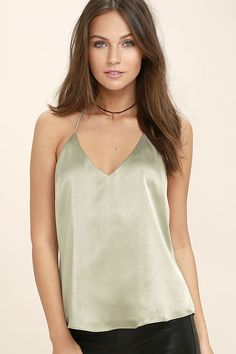 It's time to heat things up with the Spark a Fire Sage Green Satin Top! This silky satin top is just the right amount of sexy with a darted, triangle bodice and a low, strappy back.