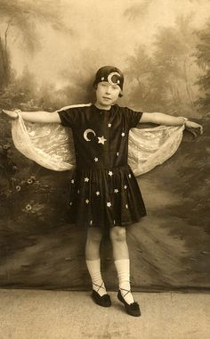 A fairy photographed by Jerome in the 1930s    Found image. The child also seems to represent the moon and stars or perhaps night.