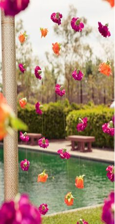 Simple hanging flowers at mandap... could use different flowers  colors in place of these carnations