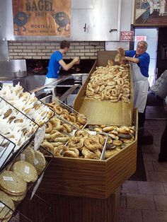 Bakers at work in the St Viateur Bagel Shop in Mile End, Montréal. Image by Tim Richards / Lonely Planet.