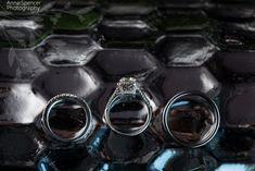 Anna and Spencer Photography, Atlanta Wedding Photographers. Wedding rings on a geometric gunmetal silver background.