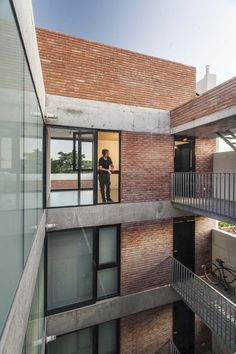 Image 2 of 22 from gallery of Pedraza Building / Luppi Ugalde Winter. Photograph by Alejandro Peral Building Design, Building A House, Brick Architecture, Chinese Architecture, Architecture Office, Futuristic Architecture, Multi Family Homes, Brick Facade, Social Housing