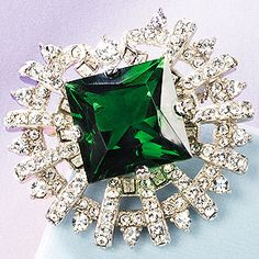 Sultan's Emerald Crystal Pin    This reproduction is centered by a hand-faceted…