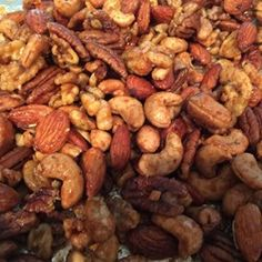 Mixed nuts, brown sugar, kosher salt, butter, and rosemary are all you need to make this tasty snack. Party Nuts Recipe, Nut Mix Recipe, Savory Nuts Recipe, Glazed Nuts Recipe, Snack Mix Recipes, Peanut Recipes, Appetizer Recipes, Appetizers, Finger Foods