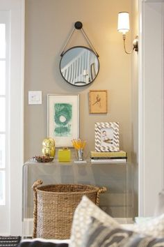 An oversized basket tucked beneath a console creates a generous amount of hidden storage.