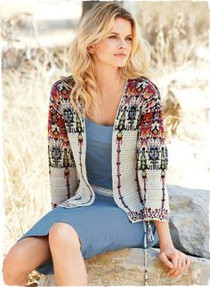 Our intriguing, double-face knit cardigan reverses from abstract tribal motifs on natural to colorful striated bands for amazing versatility. In shimmery pima, with buttonless placket, top-stitched seaming and drop shoulders.  The tasseled handwoven belt, in a checkerboard of ivory, chambray and antelope.