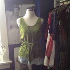 CLOSING 19 Dec: Green SILK Tory Burch Tank Top Look your best this Spring/Summer on this gorgeous Tory Burch sleeveless silk blouse! You will not be disappointed! Side zip, ties at the waist and is a great shade of green! Tory Burch Tops Tank Tops