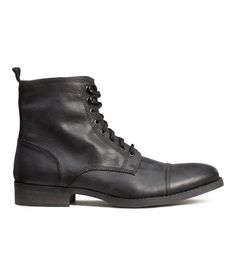 Boots in imitation leather with laces at top, zip at side, and rubber soles.