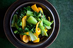 so simple and delish!  I used a red onion and red pepper for a colorful dish.    Baby Bok Choy with Yellow Bell Peppers on Simply Recipes