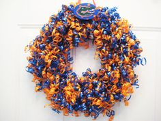I may have to make this... just minus the FL Gators.  :)  It's almost football season and this will look fantastic adorning my door!