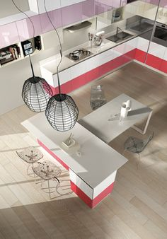 Tetrix. The concept of modularity is also  applied to the island. The table's top  is connected to the under-top of the  worktop; the low containing module  underneath enhances its aesthetics  and functionality. The colour also  personalises all sides.